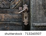 old rusty gate handle on wooden ...   Shutterstock . vector #713260507