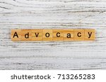 Small photo of ADVOCACY word made with wooden blocks concept