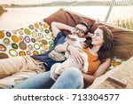 happy hipster couple with... | Shutterstock . vector #713304577