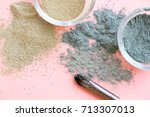 bowl of black clay mask with... | Shutterstock . vector #713307013