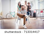 portrait of four co workers... | Shutterstock . vector #713314417