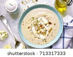 creamy cauliflower soup with... | Shutterstock . vector #713317333