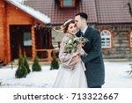 the groom tenderly kisses the... | Shutterstock . vector #713322667