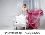young beautiful woman in a... | Shutterstock . vector #713333203
