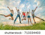 the five young people jumping  | Shutterstock . vector #713334403