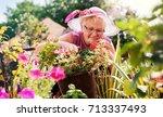smiling senior woman enjoying... | Shutterstock . vector #713337493