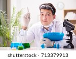 male doctor working in the lab... | Shutterstock . vector #713379913