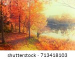 fall foliage by the lake | Shutterstock . vector #713418103