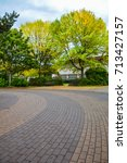 paved driveway and benches... | Shutterstock . vector #713427157