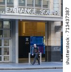 Small photo of Sydney, Australia - May 16, 2017: Man walking past the Sydney Exchange Square. ASX, Australian Securities Exchange is the company that operates Australia's stock exchange.