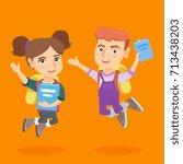 happy caucasian schoolboy and... | Shutterstock .eps vector #713438203