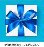 decorative gift box with blue... | Shutterstock .eps vector #713472277