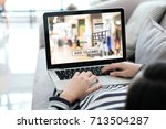 woman hand typing laptop with... | Shutterstock . vector #713504287