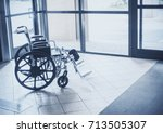 solitary wheelchair resting in... | Shutterstock . vector #713505307