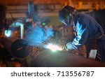 welder performs welding large... | Shutterstock . vector #713556787
