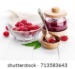 raspberry confiture in can with ... | Shutterstock . vector #713583643
