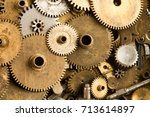 Small photo of Aged gears cogwheels macro view. Steampunk mechanical equipment and mechanism background. Shabby grunge scratch metal texture. Shallow depth of field, soft focus