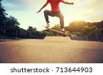 woman skateboarder... | Shutterstock . vector #713644903
