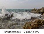 Small photo of Waves hit rocks. / Splash waves hit rocks at Koh Lan Island,PATTAYA,Thailand.