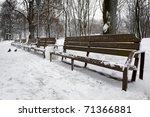 empty bench in winter park in...   Shutterstock . vector #71366881