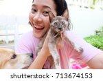 Stock photo asian woman selfie with kitten 713674153