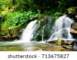 waterfall in the mountains | Shutterstock . vector #713675827