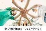 happy friends putting their... | Shutterstock . vector #713744437