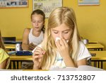 a cold girl in school | Shutterstock . vector #713752807