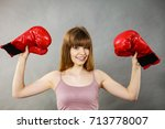 sporty woman holding red boxing ... | Shutterstock . vector #713778007