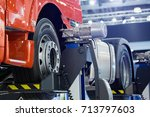 truck on a column lift in a car ... | Shutterstock . vector #713797603