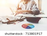 young accountant hand holding... | Shutterstock . vector #713801917