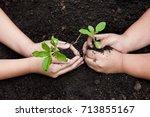 children hands planting young... | Shutterstock . vector #713855167