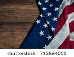america flag place on wooden... | Shutterstock . vector #713864053