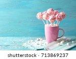 pink cake pops in a teacup | Shutterstock . vector #713869237