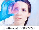 female student with petri dishes | Shutterstock . vector #713922223