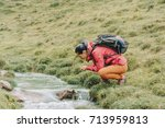 hiker young woman with backpack ... | Shutterstock . vector #713959813