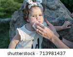 the mother is wiping the baby's ... | Shutterstock . vector #713981437