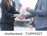 business partners fist bump... | Shutterstock . vector #713995327