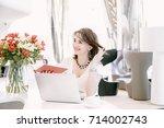 business woman. the girl speaks ... | Shutterstock . vector #714002743
