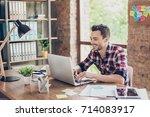 cheerful young brunet... | Shutterstock . vector #714083917