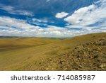 grassy  hilly terrain on the... | Shutterstock . vector #714085987