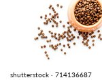 Stock photo bowl full and overflowing with dry pet dog food bits on white background top view mock up 714136687
