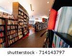blurred image of bookstore | Shutterstock . vector #714143797
