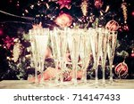filling up glasses for holiday... | Shutterstock . vector #714147433