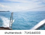 yacht sailing and vast blue sea | Shutterstock . vector #714166033
