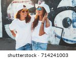 two models wearing plain white... | Shutterstock . vector #714241003