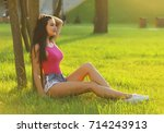 beautiful brunette girl wearing ... | Shutterstock . vector #714243913