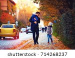 father with kids walking along... | Shutterstock . vector #714268237