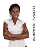 young smiling African American businesswoman wearing light shirt looking with crossed arms - stock photo