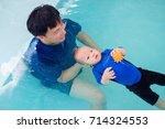 Asian Father Take Cute Little...